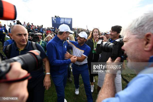 Europe's Italian golfer Francesco Molinari celebrates with Europe's Danish golfer Thorbjorn Olesen after Europe won the 42nd Ryder Cup at Le Golf...