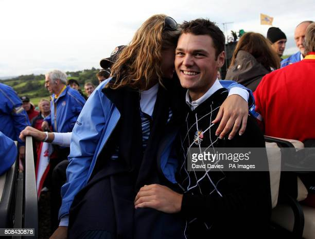 Europe's Martin Kaymer gets a hug from his partner Allison Micheletti after his victory in the fourballs during the Ryder Cup at Celtic Manor Newport