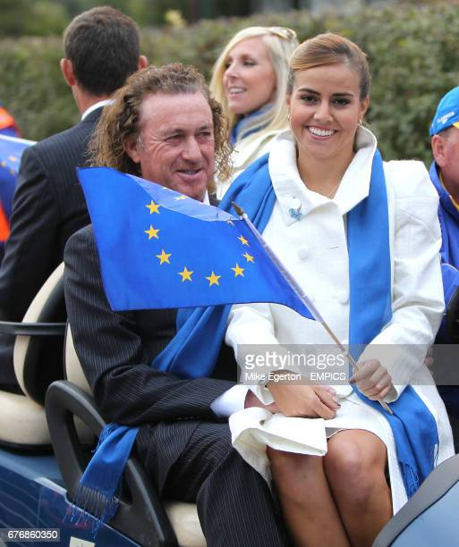 Europe's Miguel Angel Jimenez wife his wife Marian are driven away from the opening ceremony