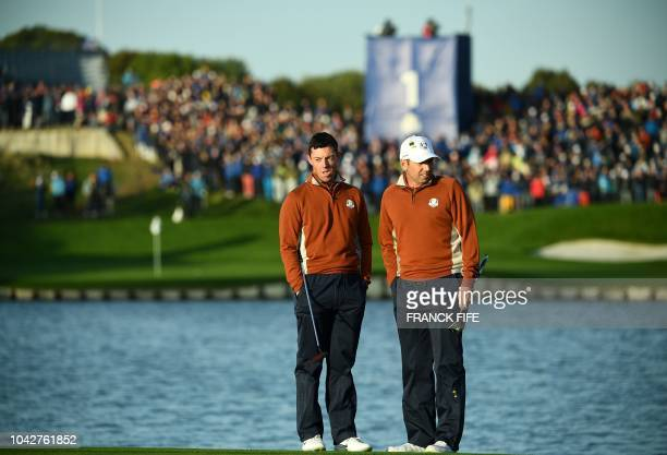Europe's Northern Irish golfer Rory McIlroy and Europe's Spanish golfer Sergio Garcia take part in their fourball match on the second day of the 42nd...
