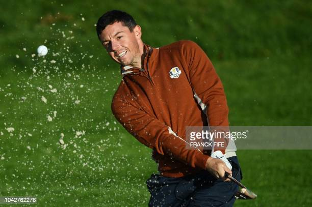 TOPSHOT Europe's Northern Irish golfer Rory McIlroy plays a fairway shot during his fourball match on the second day of the 42nd Ryder Cup at Le Golf...