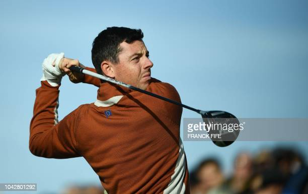 Europe's Northern Irish golfer Rory McIlroy plays a tee shot during his fourball match on the second day of the 42nd Ryder Cup at Le Golf National...