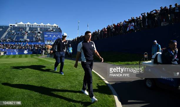 Europe's Northern Irish golfer Rory McIlroy walks during a practice session ahead of the 42nd Ryder Cup at Le Golf National Course at...