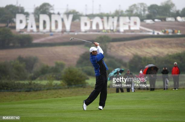 Europe's Ross Fisher plays a shot in front of a Paddy Power sign on a nearby hill during his practice round at Celtic Manor Newport