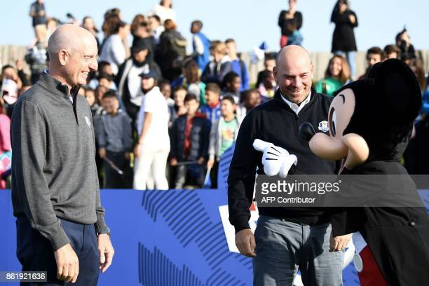 Europe's Ryder Cup captain Thomas Bjorn and US Ryder Cup captain Jim Fury joke with Mickey Mouse mascot during the 2018 Ryder Cup media day on...