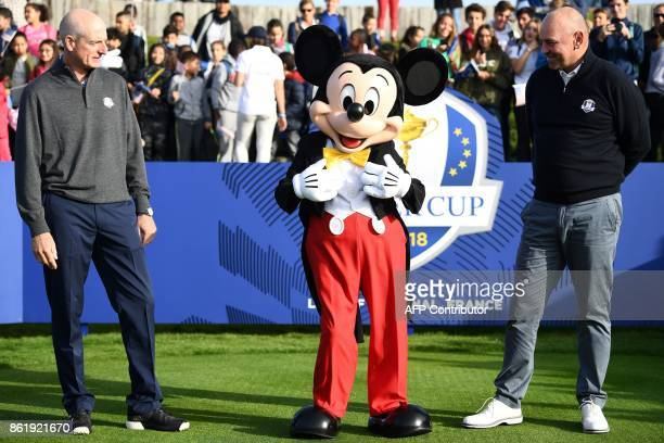 Europe's Ryder Cup captain Thomas Bjorn and US Ryder Cup captain Jim Fury pose with Mickey Mouse mascot during the 2018 Ryder Cup media day on...