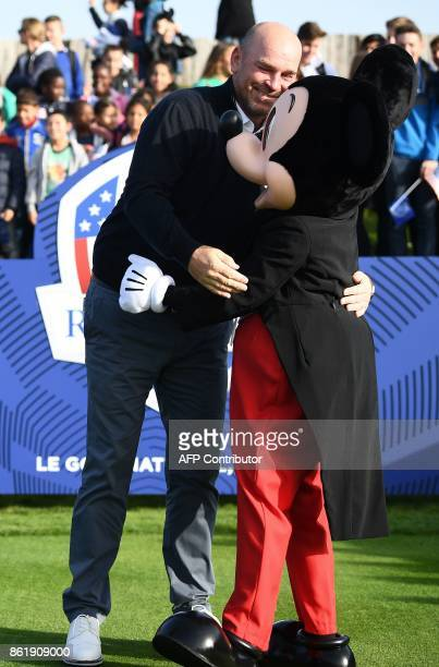 Europe's Ryder Cup captain Thomas Bjorn jokes with Mickey Mouse mascot during the 2018 Ryder Cup media day on October 16 2017 at the Golf National in...