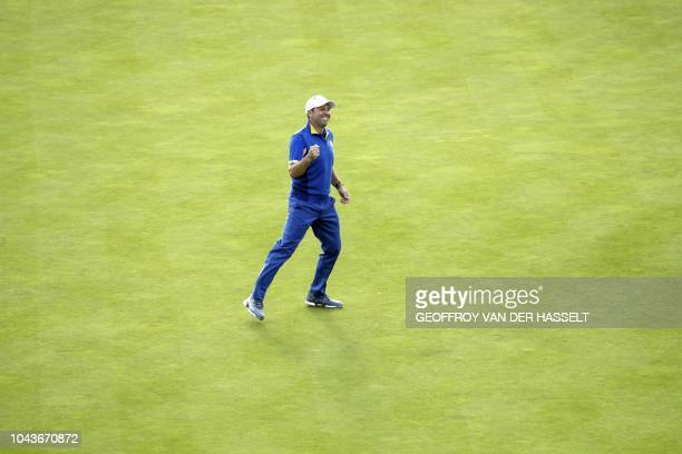 Europe's Spanish golfer Sergio Garcia celebrates after Europe won the 42nd Ryder Cup at Le Golf National Course at Saint-Quentin-en-Yvelines,...