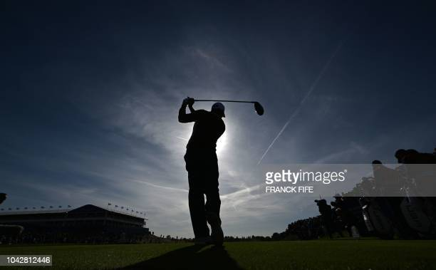 Europe's Spanish golfer Sergio Garcia plays a tee shot during his fourball match on the second day of the 42nd Ryder Cup at Le Golf National Course...