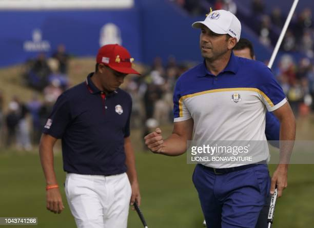 Europe's Spanish golfer Sergio Garcia reacts during his singles match with US golfer Rickie Fowler on the third day of the 42nd Ryder Cup at Le Golf...
