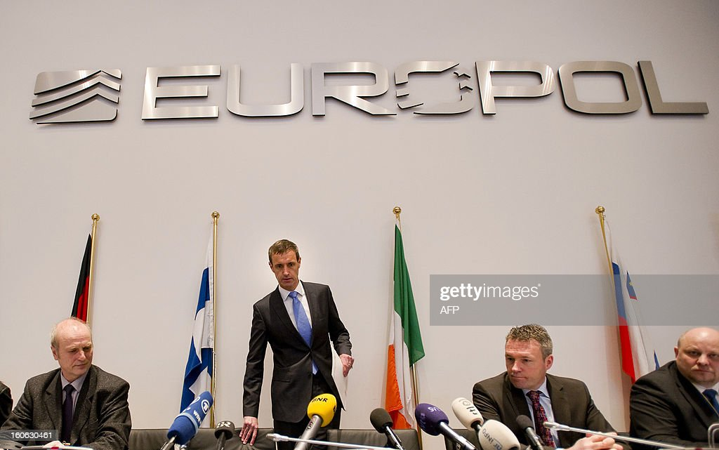 Europol's chief Rob Wainwright (2nd-L) arrives for a press conference next to Friedhelm Althans, chief investigator of Bochum police (L) and Andreas Bachmann (2R) from the Bochum prosecution service, in The Hague on February 4, 2013 after the police smashed a criminal network suspected of fixing 380 football matches, including in the Champions League and World Cup qualifiers. 'It is clear to us that this is the biggest investigation ever into suspected match fixing,' Wainwright told journalists. AFP PHOT / ANP / ROBIN VAN LONKHUIJSEN netherlands out - belgium out
