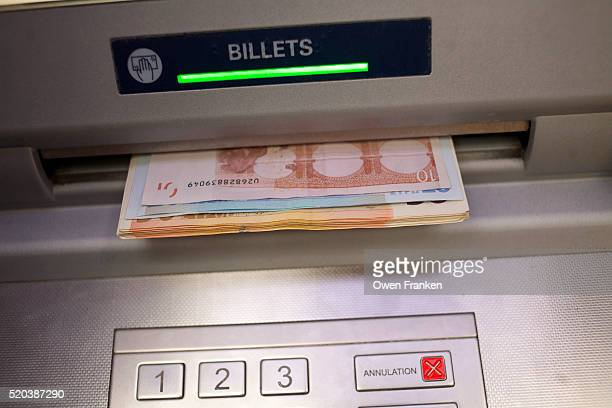 euros coming out of a bank cash machine in Paris