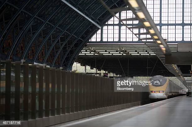 A Eurostar passenger train operated by Eurostar International Ltd pulls out of a platform as it departs from St Pancras rail station in London UK on...