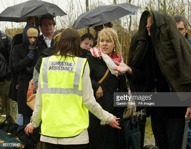 Eurostar passengers queue in pouring rain at Ashford International Station in Kent as Eurostar services were disrupted by a collapsed house in Ridley...