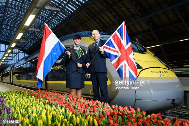 Eurostar staff members Emma Jane Timperley and Stephane Aupre are seen as the inaugural Eurostar service sets off from London to Amsterdam as ticket...
