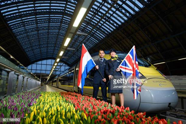 Eurostar staff members Silvester Entong and Kimberley Schaap are seen as the inaugural Eurostar service sets off from London to Amsterdam as ticket...
