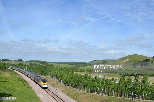 eurostar train approaching the channel tunnel - eurostar stock pictures, royalty-free photos & images