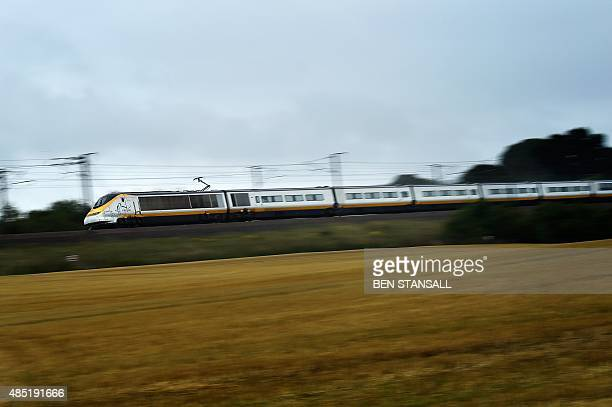 A Eurostar train travels through the countryside near Folkestone in Kent south east England on August 25 2015 AFP PHOTO / BEN STANSALL