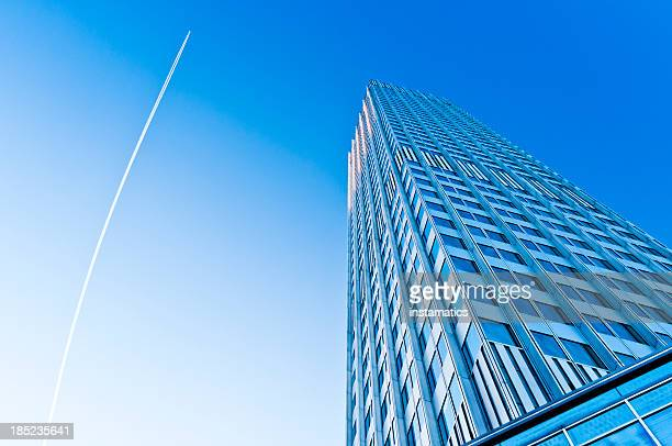 eurotower with blue sky and jet trail - european central bank stock photos and pictures