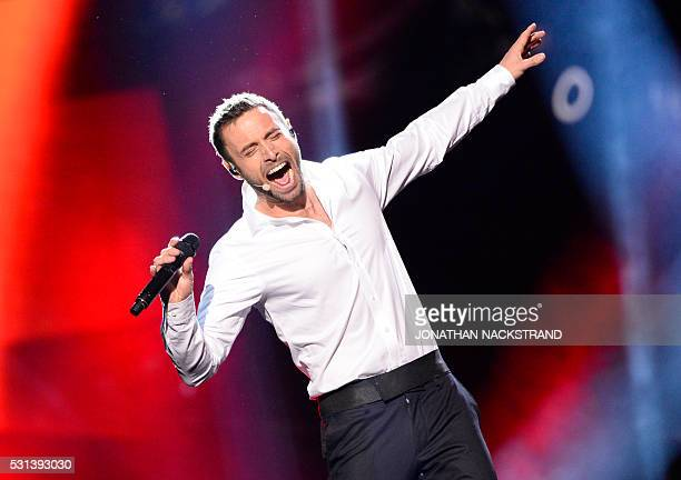 Eurovision host Mans Zelmerlow performs during the final of the Eurovision Song Contest 2016 Grand Final in Stockholm on May 14 2016 / AFP / JONATHAN...