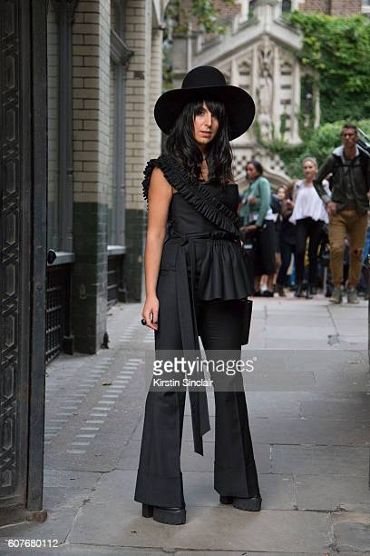 Eurovision singer and 2016 winner Jamala is wearing jumpsuit jacket and shoes by Yelena Reva bag by Kofta day 1 of London Womens Fashion Week...