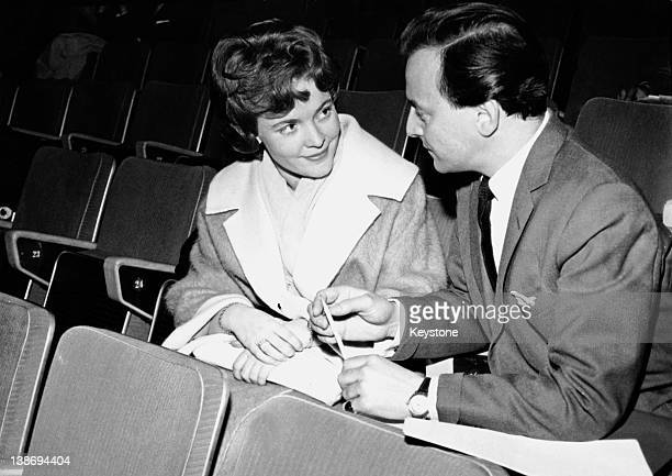 Eurovision Song Contest entrant Katy Bodtger of Denmark talks to compere David Jacobs during rehearsals at the Royal Festival Hall in London 28th...