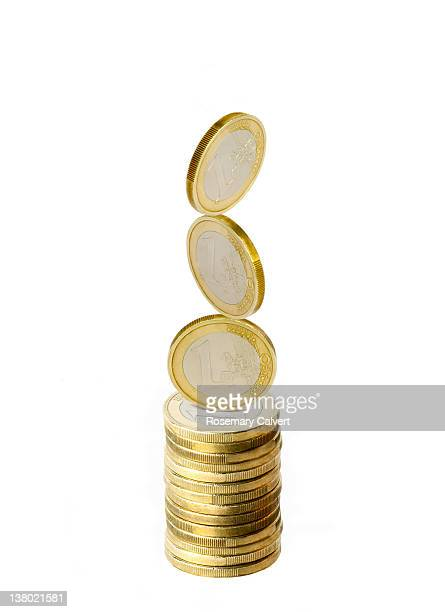 Eurozone currency, balanced and stacked coins.