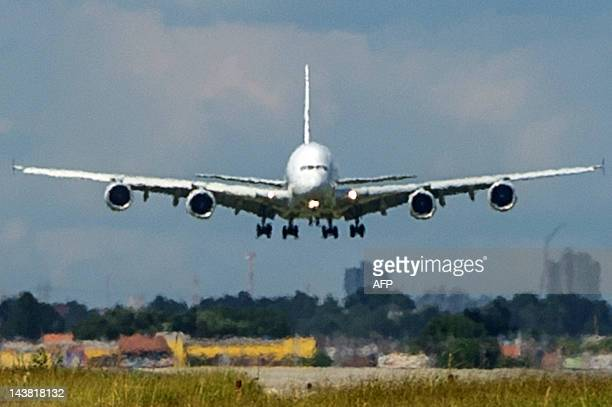 Eurpean aircraft manufacturer Airbus' A380 the world's largest doubledeck jet airliner lands at Guarulhos international airport in the outskirts of...
