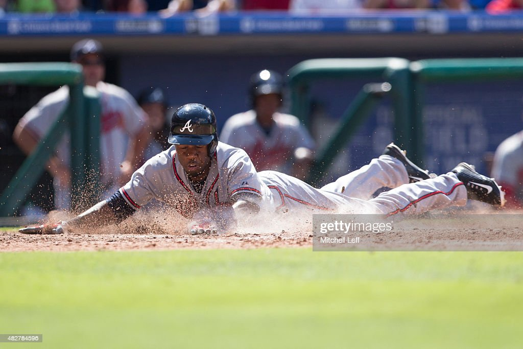 Eury Perez #14 of the Atlanta Braves slides home safely in the top of the seventh inning against the Philadelphia Phillies on August 2, 2015 at the Citizens Bank Park in Philadelphia, Pennsylvania. The Braves defeated the Phillies 6-2.