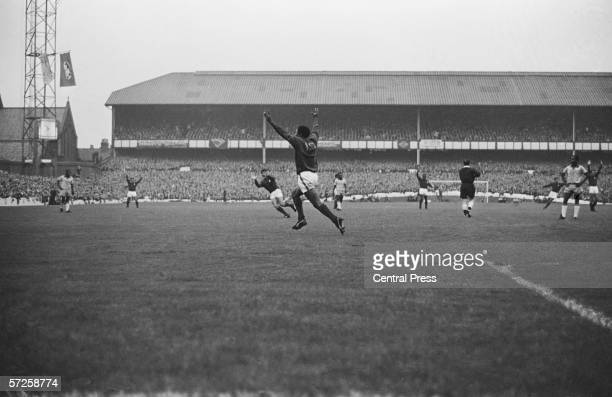 Eusebio centre celebrates scoring Portugal's second goal in the Group C match against Brazil at Goodison Park during the 1966 World Cup in England...