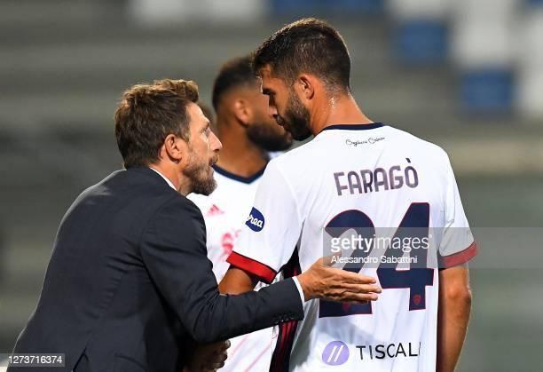 Eusebio Di Francesco head coach of Cagliari Calcio issues instructions to Paolo Faragò of Cagliari Calcio during the Serie A match between US...