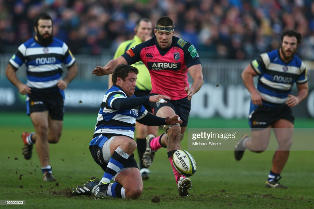Eusebio Guinazu (L) of Bath pounces on the loose ball as James Down of Cardiff Blues loses in during the LV Cup match between Bath and Cardiff Blues at the Recreation Ground on January 25, 2014 in Bath, England.