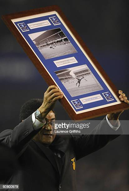 Eusebio is presented with an award to commemorate his return to Goodison Park where he scored six goals during the 1966 World Cup prior to the UEFA...