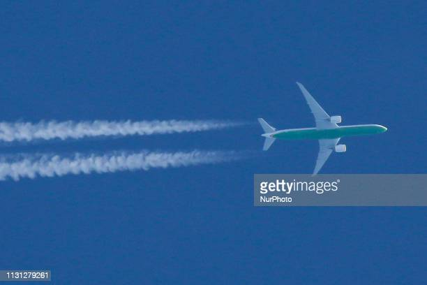 Eva Air Boeing B777300ER airliner overflying Europe in blue sky The aircraft is flying at 36000 feet leaving contrails behind Eva Air the Evergreen...