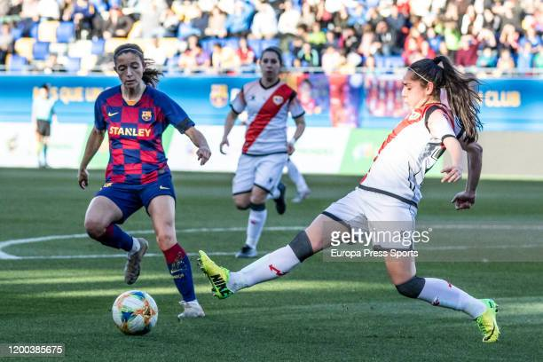 Eva Alonso of Rayo Vallecano competes with Aitana Bonmati of Fc Barcelona during the Spanish League Primera Iberdrola women football match played...