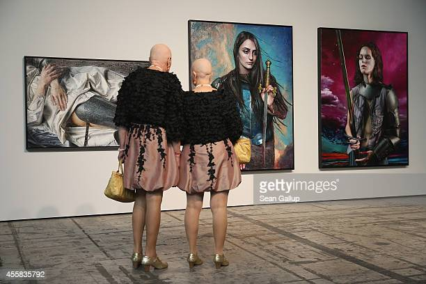 """Eva and Adele look at a work by Martin Eder at the """"art berlin contemporary"""" art trade fair at The Station on September 20, 2014 in Berlin, Germany...."""