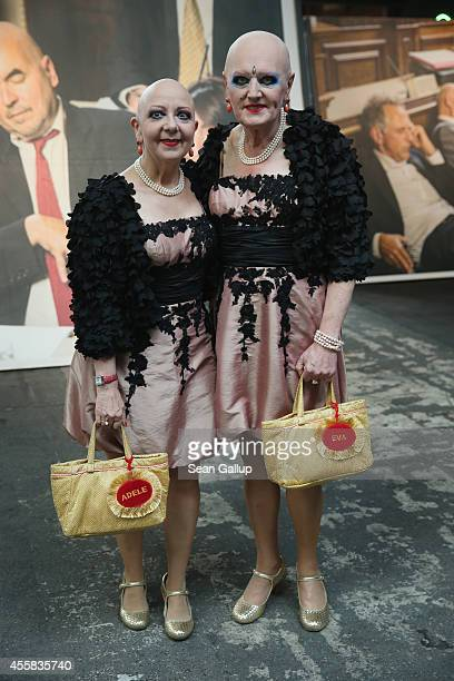 """Eva and Adele stand in front of a work by G.R.A.M. At the """"art berlin contemporary"""" art trade fair at The Station on September 20, 2014 in Berlin,..."""