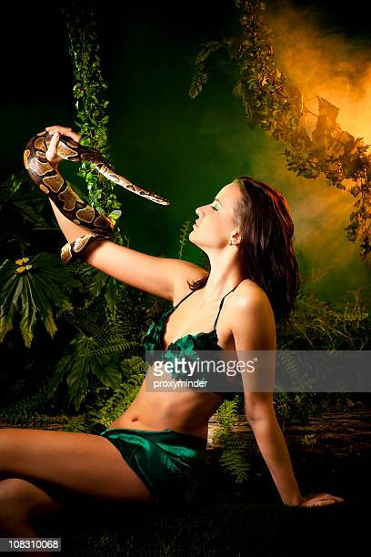 eva and snake - garden of eden old testament stock photos and pictures