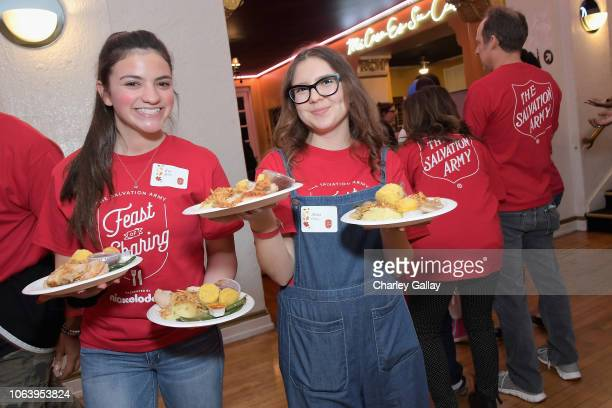 Eva Bella and Alina Foley attend Salvation Army NICKELODEON Feast of Sharing on November 20 2018 in Los Angeles California