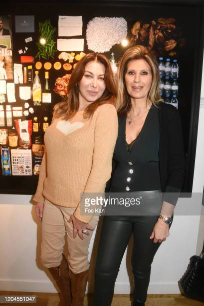Eva Benhamou editor in chief of First Luxe Signature and Odile Jagnaud pose with a picture of the Mick Jagger's dustbin contents during Paparazzi...
