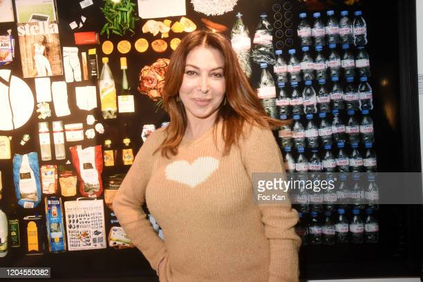 Eva Benhamou editor in chief of First Luxe Signature poses with a picture of the Mick Jagger's dustbin contents during Paparazzi Bruno Mouron et...