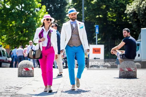 Eva Berni and Niccolo Cesari in fluo pants and white jacket are seen during Pitti Immagine Uomo 92 at Fortezza Da Basso on June 15 2017 in Florence...