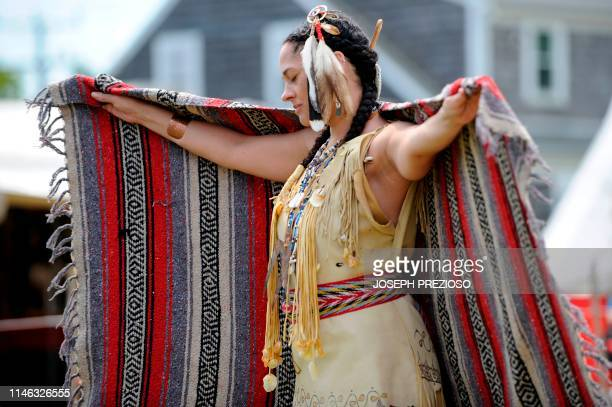 Eva Blake of the Assonet Wampanoag Tribe takes part in the blanket dance during the 29th Annual Spring Planting Moon Pow Wow run by the Massachusetts...