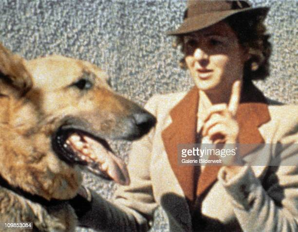 Eva Braun and Blondi, Adolf Hitler's German shepherd, at the Berghof, Hitler's residence near Berchtesgaden, Germany, 1942. Eva Braun had a dislike...