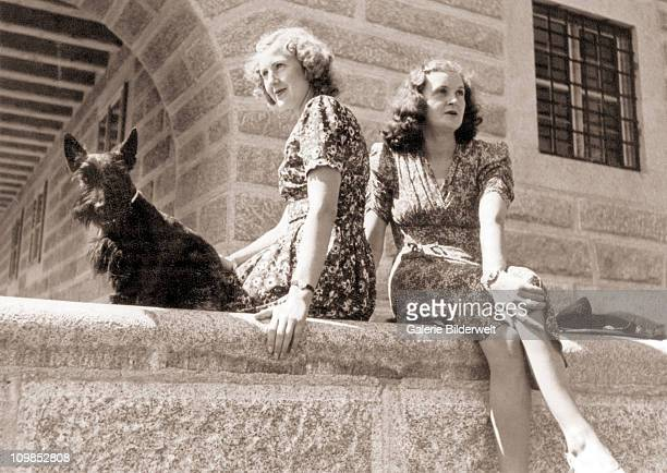 Eva Braun and her younger sister Margarethe 'Gretl' Braun with the Scottish terrier Negus at the Kehlsteinhaus above Berchtesgaden, Germany, 1943....