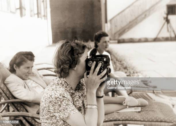 Eva Braun filming with her 16mm camera at Berchtesgaden, Germany, 1942. Occasionally she used color film and many years later these films became...