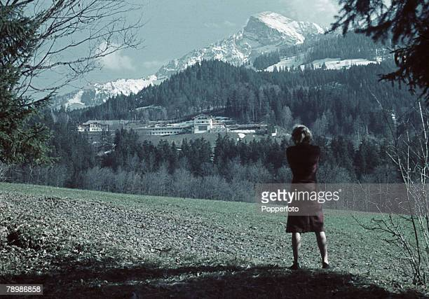 Eva Braun , future wife of Adolf Hitler, takes a photograph of the Berghof, Adolf Hitler's Bavarian retreat, in Obersalzberg near Berchtesgaden,...