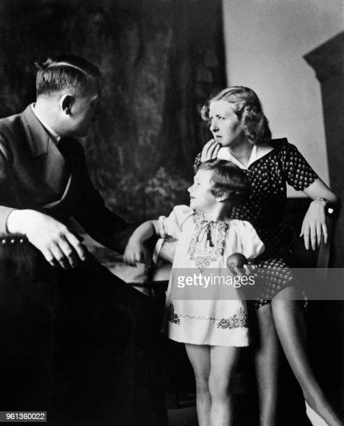 Eva Braun poses with Ursula Uschi Schneider daughter of her best friend Herta Schneider and her companion Adolf Hitler Führer of the German Reichin...