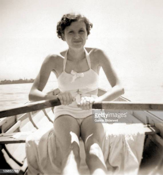 Eva Braun rowing a boat on the Worthsee near Munich, 1937. She had started a relationship with Adolf Hitler in 1931 and moved into the Berghof, his...