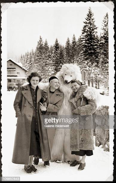 Eva Braun with two women and a person dressed as a polar bear in the Bavarian Alps, Germany, 1935.